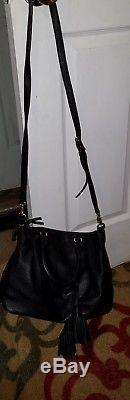 Tory Burch black slouchy bag with tassel and adjustable shoulder strap