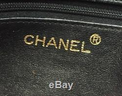 Vintage Chanel black quilted lambskin leather purse with wide leather strap